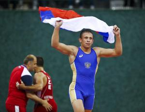 Saleev of Russia celebrates after winning his final fight of the Men's 80Kg greco-roman wrestling
