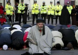 File photograph shows Muslim cleric Abu Hamza al-Masri leading prayers outside the North London Central Mosque, in north London