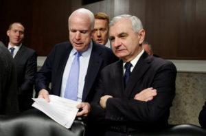 McCain talks with Reed at the start of the committee's hearing on foreign cyber threats, on Capitol Hill in Washington